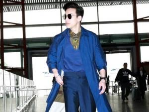 王冠逸机场街拍 风衣墨镜尽显摩登绅士风