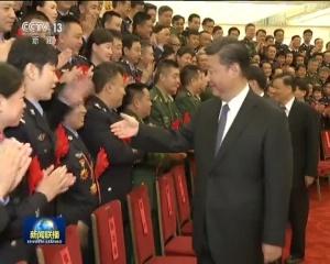 习近平会见全国公安系统英雄模范立功集体表彰大会代表