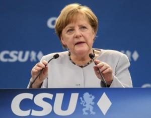 默克尔敦促欧盟加强团结应对美欧分歧(组图)