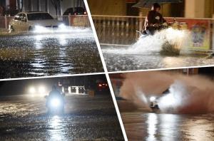 """高清:暴雨致罗城街道内涝 车如""""行舟"""""""