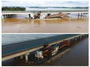 挖沙船被洪水冲击走锚 撞上梧州浔江特大桥(图)
