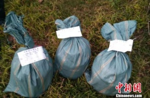 三男子丢弃毒品逃命 云南警方查获冰毒60公斤(图)