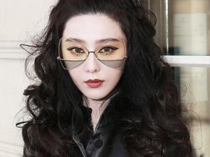 """范冰冰戴自家个性""""蝴蝶眼镜"""" LV秀场外帅气"""