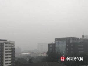 北京周一早高峰迎降雨天气阴凉(组图)