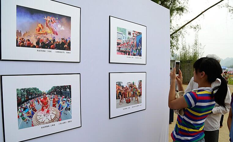 广西上林举办摄影作品展:壮族老家 上品上林