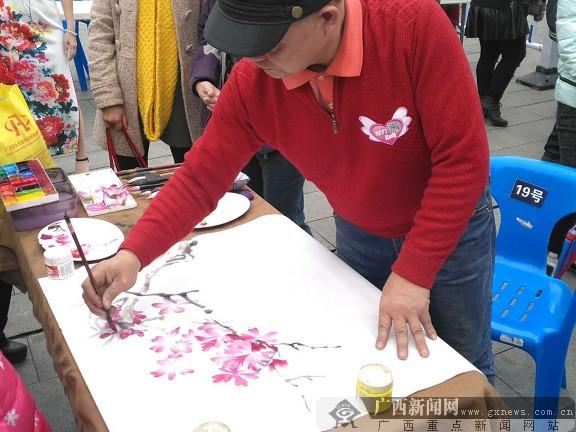 鱼峰区举行2017紫荆诗会暨春彩摄影绘画文化活动