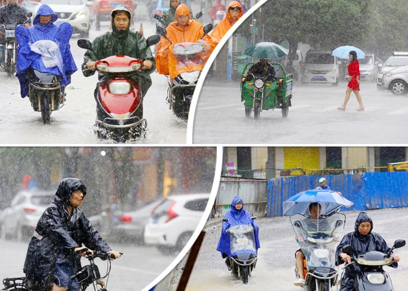 高清:融安突下暴雨 居民在雨中艰难前行