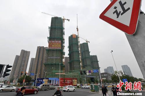 资料图:商品房在建中。 <a target='_blank' href='http://www.chinanews.com/'></table>中新社</a>记者 吕明 摄