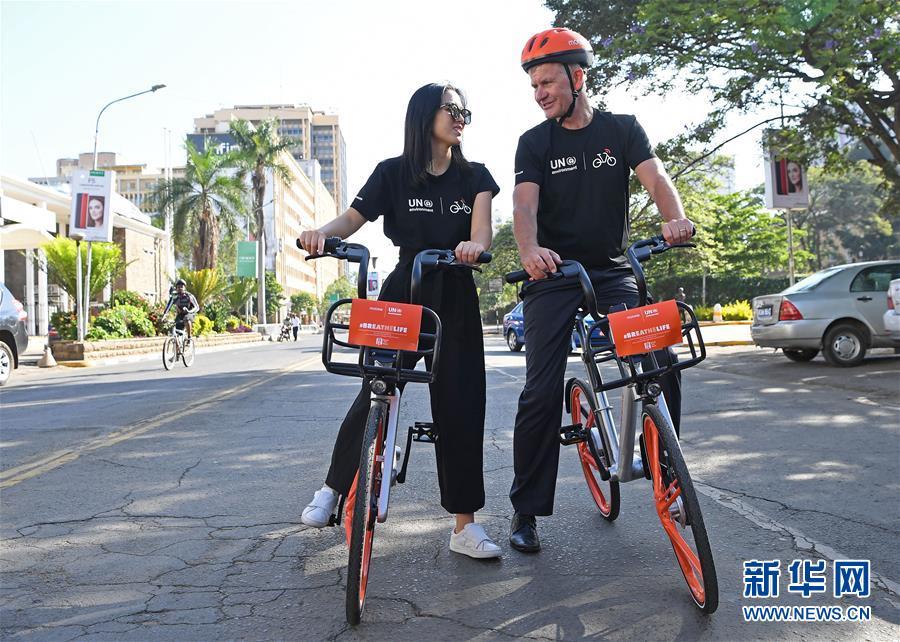 (国际・图文互动)(1)中国共享单车橙色旋风闪现非洲街头