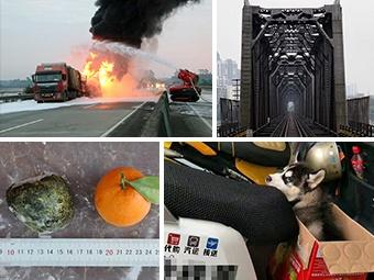 14日焦点图:油罐车追尾大货车爆燃 现场浓烟滚滚