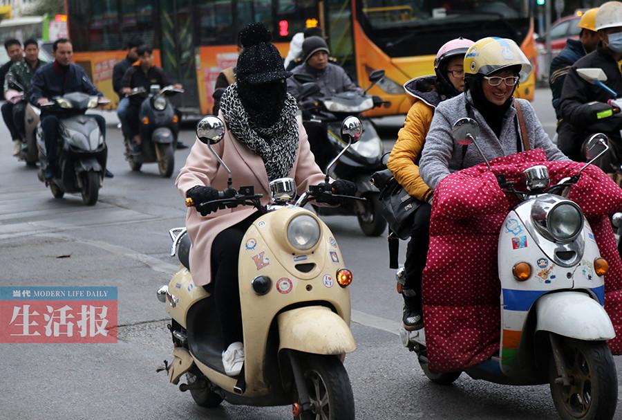 阴冷天气来袭广西大部有小雨 出门请备好雨具(图)