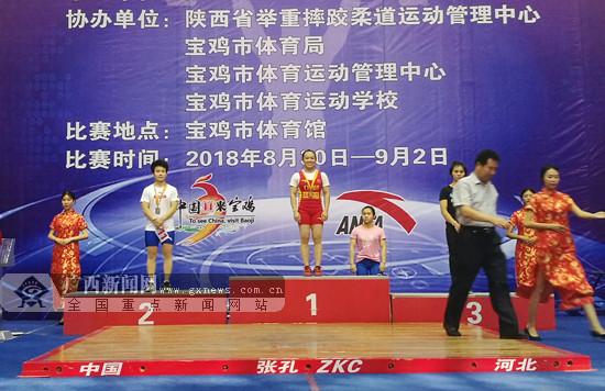 蒋惠花包揽49公斤级抓举、挺举和总成绩三枚金牌