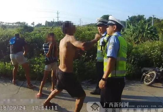 防城港男子驾车超员遭查 拳打交警被刑拘