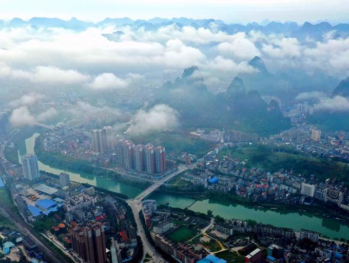 仙气十足!河池市金城江区现雾海壮观奇景(图)