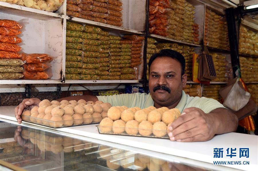 """养金钱龟赚钱吗南亚地区传统甜点""""拉杜"""""""
