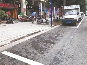 """公共停车位被""""私占""""整治还需多措并举"""