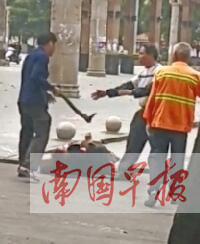 博白一男子當街持棍擊打妻子被行拘10日(圖)