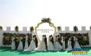 防城港边防支队10对新婚官兵举行集体婚礼(组图)