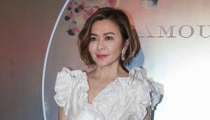关之琳穿白色蓬蓬裙 凹造型秀好身段