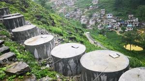 """大化:大石山上""""同心水柜""""为贫困群众引来放心水"""