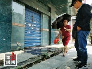 桂林一家廢棄酒店冒污水 附近居民叫苦不迭
