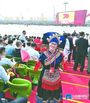 """幸福而驚喜的""""國慶之旅""""——訪全國民族團結進步模范個人覃鈺"""