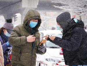 哈尔滨:雪中保防控