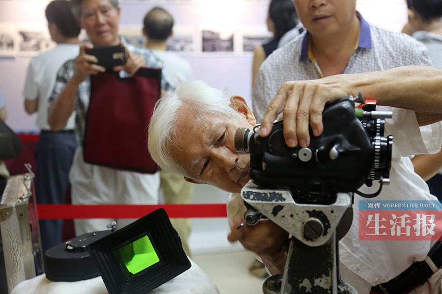 摄影师扎根广西60年 记录八桂热土发展变迁(组图)
