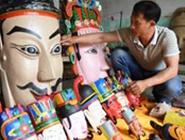 毛南族傩面雕刻传人方文展