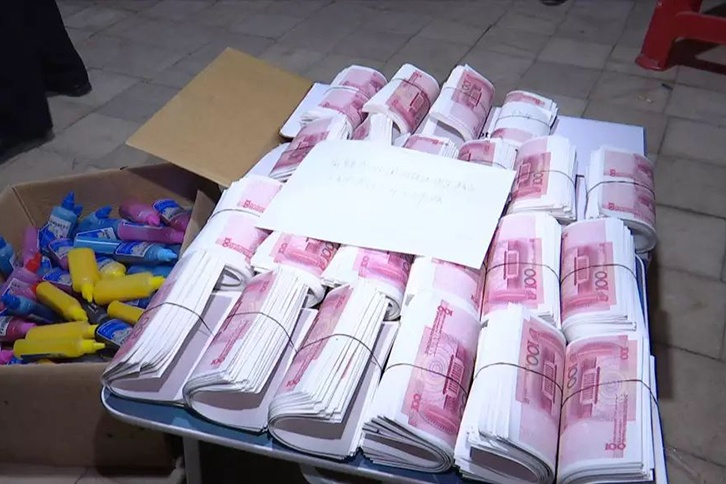 焦点图:制售假币近1200万!一造假窝点在贺州被端
